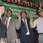 Trump looks on as boxing promoter Don King holds up the wrists of heavyweight champion Mike Tyson and challenger Larry Holmes in 1987. Less than two months later, Tyson knocked out Holmes in the fourth round.