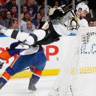 New York Islanders center Micheal Haley flips Deryk Engelland of the Pittsburgh Penguins during the Penguins' 4-3 win.  Haley was given a two-minute penalty for the hit.