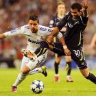 Tottenham Hotspur midfielder Sandro uses every part of his body to deny Real Madrid forward Cristiano Ronaldo during a Champions League quarterfinal leg on April 5.  Real Madrid would thrash Tottenham 4-0.