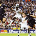 Real Madrid's Emmanuel Adebayor uses his head to score against Tottenham Hotspur during the first leg of their Champions League quarterfinal match.  Real Madrid would go on to win 4-0.