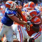 Florida Gators offensive lineman William Steinmann (left) tussles with Gators defensive lineman Omar Hunter during the Orange and Blue spring football game in Gainesville, Fla.