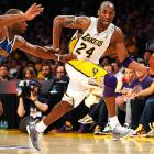 Los Angeles Lakers guard Kobe Bryant slips by New Orleans Hornets forward Carl Landry during their Western Conference quarterfinals match, but Bryant and his 34 points were not enough to overcome the Hornets, who defeated the Lakers 109-100.