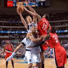 Dirk Nowitzki (top left) goes over the back of center Tyson Chandler for a layup during Game 1 of the Trail Blazers-Mavericks game in the first round of the NBA playoffs.  Nowitzki would score 28 points during the Mavericks' 89-81 victory.