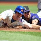 New York Mets second baseman Daniel Murphy and Colorado Rockies third baseman Ian Stewart race to the bag during the Mets' 6-5 loss to the Rockies in the first game of a doubleheader. The Mets would lose the second game of the doubleheader as well.