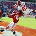 Eager to show he can fill the shoes of departed wide receiver Julio Jones, sophomore wide receiver Kevin Norwood (83) goes vertical for a pass during the Alabama spring game.
