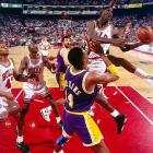 Jordan punctuated a 15-for-18, 33-point, 13-assist performance in Game 2 of the Finals with an acrobatic masterpiece. Driving the lane, he brandished the ball with his right hand as if preparing to dunk. However, while in midair, he suddenly switched hands and scooped a shot in from the left side. The Bulls romped 107-86, the first of four consecutive victories in a run to the franchise's first title.