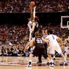 """Two miraculous tournament runs led to the unlikeliest of title games -- but Monday's showdown in Houston was historic for different reasons. """"March Madness"""" lived up to its moniker as Butler made its second straight appearance in the championship game, but just like last year, the underdog's efforts ultimately fell short. Behind Kemba Walker and a stifling defense, the Huskies held the Bulldogs to the worst shooting percentage in title game history, a woeful 19 percent, and clawed their way to a 53-41 victory. The win gave Jim Calhoun his third career NCAA title, something only four other coaches have done in history.   Click through our gallery to check out SI's best photos from the 2011 title game ..."""