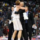 UConn freshman Niels Giffey embraces Jim Calhoun following the team's win.