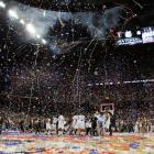 Confetti falls to the court as the Huskies celebrate their first NCAA title since 2004.