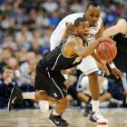 Butler guard Ronald Nored fights for the ball against UConn big man Charles Okwandu. Nored finished with just two points and four rebounds in the loss.