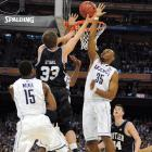 Butler guard Chase Stigall takes it to the rim and is denied by UConn's Charles Okwandu on his way up. The Huskies finished the game with 10 blocks and dominated the smaller Bulldogs inside all game long.