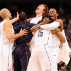 """UConn players celebrate on the floor after the buzzer sounds. As Jim Nantz said on his telecast, """"The Huskies are top dog in 2011."""""""