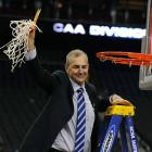 For the third time in his career, Jim Calhoun cuts down the net following an NCAA title victory.