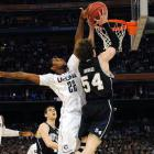 Butler forward Matt Howard goes up for a two-handed slam only to be denied by UConn's Roscoe Smith in the first half. Howard finished with seven points and six rebounds, but shot a dreadful 1-of-13 from the field.