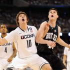 UConn's Tyler Olander and Butler's Andrew Smith fight for position underneath as a rebound bounces off the rim. The Huskies outscored the Bulldogs 26-2 in the paint.