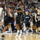Butler's Ronald Nored and Shelvin Mack celebrate at halfcourt following Mack's buzzer beater.