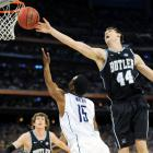Butler big man Andrew Smith gets a hand on a scoop shot by UConn's Kemba Walker, sending the ball out of bounds.