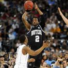 Butler's Shawn Vazant -- one of five seniors on the Bulldogs -- looks to pass the ball over UConn's swarming defense.