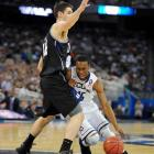 UConn star Kemba Walker drives to the hoop and attempts to create some offense early on.