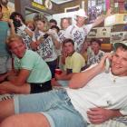 Favre takes a call from the Falcons while surrounded by friends and family in his bedroom. Atlanta drafted Favre in the second round but traded him to Green Bay the following season. The rest is history: Favre started 297 straight games, won three MVPs and led the Packers to the 1997 Super Bowl title.