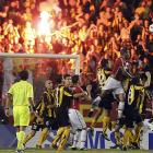 As we understand it, the rules of international soccer dictate that no match be played without a conflagration in the stands. Herewith, the crowd at Beira Rio Stadium in Porto Alegre, Brazil, wholeheartedly comply while Internacional and Penarol battle it out on the pitch.