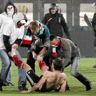 In dramatic football action, enthusiastic partisans helped themselves to souvenirs -- right off the hoof -- after the Polish Cup final between Legia Warsaw and Lech Poznan in Bydgoszcz on May 3.
