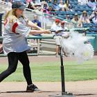 """The  In Plain Sight  star has what you'd call """"explosive power"""" and here it is on display during a celebrity softball tournament at Isotopes Park in Albuquerque."""