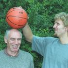 Nowitzki shows off his height advantage over long-time coach and mentor Holger Geschwindner, who spotted a 15-year-old Dirk at a tournament and helped him refine his game.