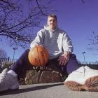 Nowitzki poses for a photo in Dallas a day before his first NBA game. He would play 16 minutes in a loss to Seattle, shooting 0-for-5 from the field and scoring two points on free throws.