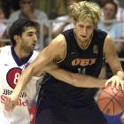 An NBA battle continues overseas as Kings forward Peja Stojakovic (Yugoslavia) guards Mavericks forward Nowitzki during the European Basketball Championship in Turkey.