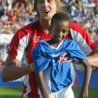 """Nowitzki hangs out shortly before the sixth Goodwill Soccer Match """"Game of Hearts"""" at the Carl Benz Stadium in Mannheim, Germany. The basketball star joined Formula One driver Michael Schumacher and others at the event to benefit the UNESCO foundation, """"Education for Kids in Despair."""""""