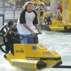 The basketball star drives in the Wellenflug coaster during his visit to Legoland Germany.