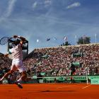 France's Julien Benneteau plays a forehand during his match with Rui Machado of Portugal. Benneteau won 4-6, 6-1, 6-2, 6-0.