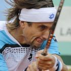 Spain's David Ferrer hits a return to Finland's Jarkko Nieminen during their first-round match. Ferrer won 6-3, 6-3, 6-1.