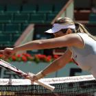 Canada's Aleksandra Wozniak argues over a point during her match with Caroline Wozniacki.