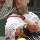 American Mardy Fish returns during his second-round match with Robin Haase of the Netherlands. Fish won in straight sets.