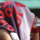 Vera Zvonareva of Russia covers her face with a towel as she drinks in between games during her fourth-round match with compatriot Anastasia Pavlyuchenkova. The third-seeded Zvonareva lost 7-6(4), 2-6, 6-2.