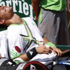 A physiotherapist massages the leg of Italy's Fabio Fognini during his fourth-round match against Albert Montanes of Spain. Fognini won 4-6, 6-4, 3-6, 6-3, 11-9.