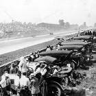 Cars approach the finish line at the first Indy 500. Indianapolis Motor Speedway, where the race is held each year, opened in 1909.