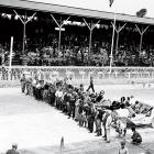In this photo taken by automobile pioneer Henry Ford, drivers line up with their cars before the start of the inaugural Indy 500.