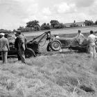 The driver watches as his car is towed at Indianapolis Speedway. He finished 28th after crashing on Turn 1 of his 122nd lap.