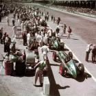 Members of the pit crews go to work during the race. Mauri Rose won his second straight Indy 500 after leading 81 of the 200 laps.