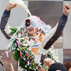 Bryan Herta Autosport driver Dan Wheldon of England pours milk on himself after winning the 100th anniversary of the Indianapolis 500.