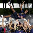 Barcelona defender Eric Abidal celebrates with his teammates after Barcelona won the Spanish League title for the third straight year.