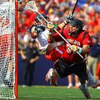 Maryland's Brian Farrell (right) tried to lead a comeback with this late goal in the NCAA lacrosse Division I championship game, but Virginia held on to defeat the Terrapins 9-7. The win marked Virginia's fourth national title under coach Dom Starsia, the winningest coach in college lacrosse history.
