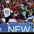 Barcelona goalkeeper Victor Valdes (right) and Manchester United striker Wayne Rooney engage in some mid-air combat during Barcelona's 3-1 victory in the Champions League final.