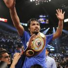 Pacquiao celebrates after the official announcement of the judges' scorecards.