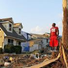 Former Crimson Tide star Arenas looks at the destruction on the street where he lives.