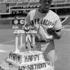 Mays eats part of the birthday cake presented to him before the start of a game with the Phillies on May 6, 1972. The outfielder was traded to the Mets a week later.