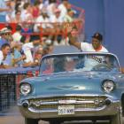 Mays rides in a convertible, waving to cheering fans, at the Giants' Old-Timers Day in 1988.